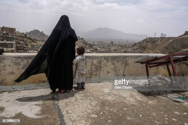 A OUTSKIRTS SANA Khairy a mother of three stands on the roof of her temporary home in Sana'a