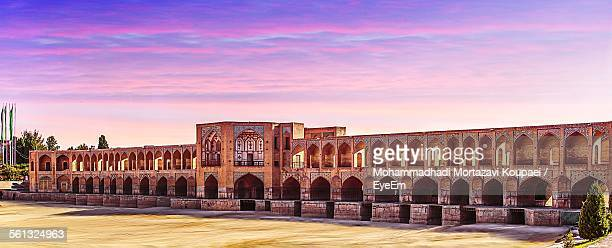 khaju bridge against cloudy sky during sunset - isfahan stock pictures, royalty-free photos & images