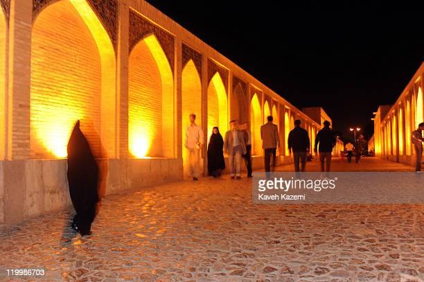 Khaju Bridge at night. Khaju Bridge is arguably the finest bridge in the province of Isfahan, Iran. It was built by the Persian Safavid king, Shah...