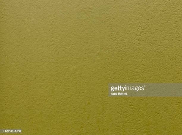 khaki green plastered rusty concrete wall - khaki green stock pictures, royalty-free photos & images