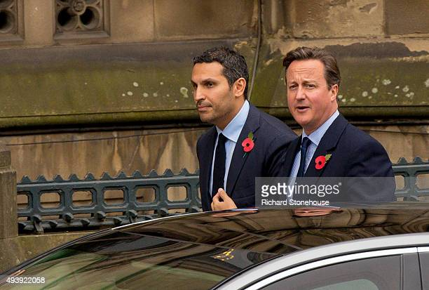 Khaldoon Al Mubarak and Prime Minister David Cameron waits for President Xi Jinping to arrive to have lunch at Manchester Town Hall on October 23...