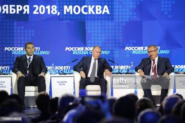 Khaldoon Al Mubarak chief executive officer of Mubadala Investment Co left Vladimir Putin Russia's president center and Andrey Kostin chief executive...