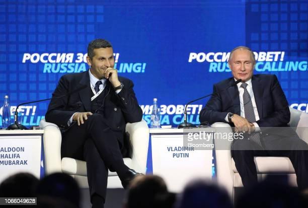 Khaldoon Al Mubarak chief executive officer of Mubadala Investment Co left and Vladimir Putin Russia's president react during the plenary panel at...