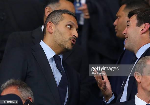 Khaldoon Al Mubarak, Manchester City Chairman chats to politician , Andy Burham during the Vincent Kompany testimonial match between Manchester City...