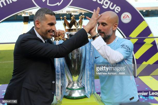 Khaldoon Al Mubarak the chairman of Manchester City and Pep Guardiola the head coach / manager of Manchester City with the Premier League trophy...