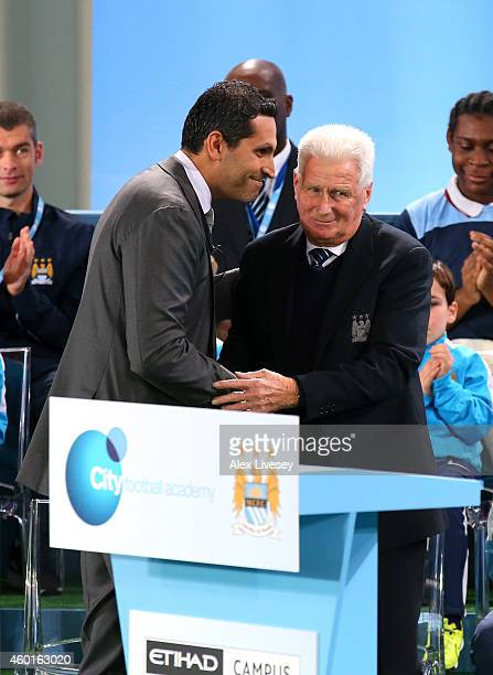 Khaldoon Al Mubarek the Manchester City Chairman talks with Tony Book a former Manchester City captain during the official Launch of the Manchester...