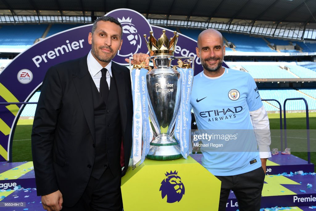 Khaldoon al-Mubarak, Manchester City chairman and Josep Guardiola, Manager of Manchester City pose with the Premier League trophy as Manchester City win the Premier League after the Premier League match between Manchester City and Huddersfield Town at Etihad Stadium on May 6, 2018 in Manchester, England.