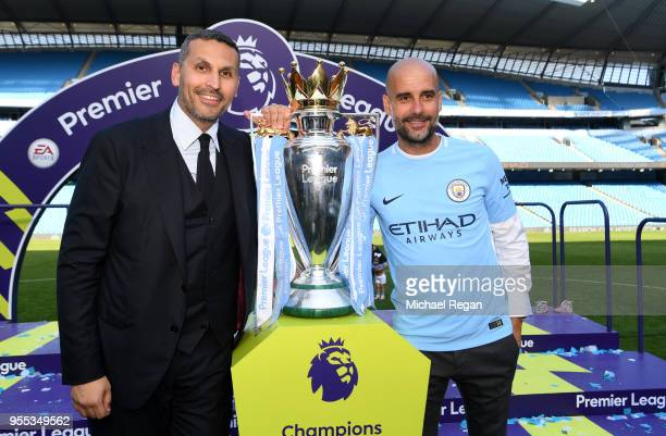 Khaldoon alMubarak Manchester City chairman and Josep Guardiola Manager of Manchester City pose with the Premier League trophy as Manchester City win...
