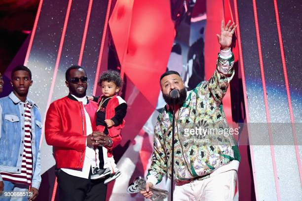 Khaled accepts HipHop Song of the Year for 'Wild Thoughts' from PDiddy and Christian Combs onstage during the 2018 iHeartRadio Music Awards which...