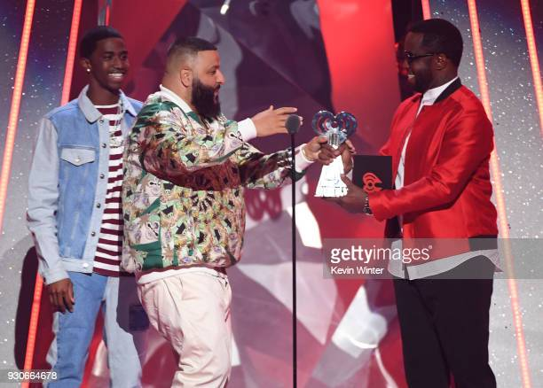 Khaled accepts HipHop Song of the Year for 'Wild Thoughts' from Sean 'Diddy' Combs onstage during the 2018 iHeartRadio Music Awards which broadcasted...