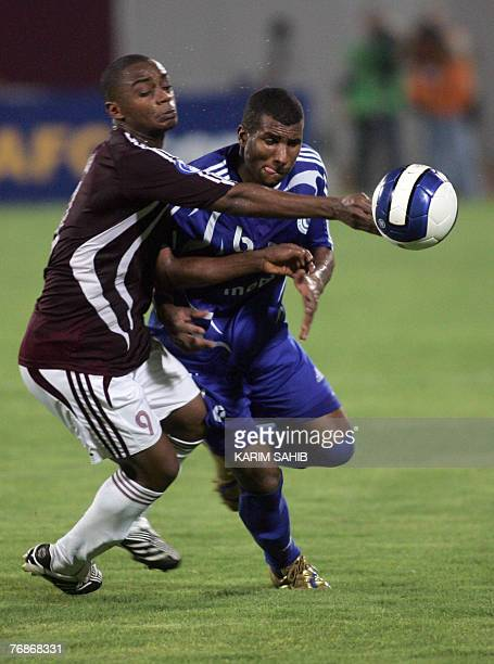 Khaled alThaker of Saudi Arabia's alHilal club vies for the ball with Said Abdullah of Emirati club alWehda during their Asian Champions League 2007...
