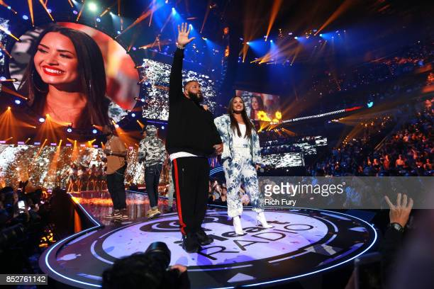 Khaled and Demi Lovato perform onstage during the 2017 iHeartRadio Music Festival at TMobile Arena on September 23 2017 in Las Vegas Nevada