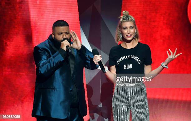 Khaled and Hailey Baldwin speak onstage during the 2018 iHeartRadio Music Awards which broadcasted live on TBS TNT and truTV at The Forum on March 11...