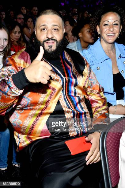 Khaled and Nicole Tuck in the audience at Nickelodeon's 2017 Kids' Choice Awards at USC Galen Center on March 11 2017 in Los Angeles California