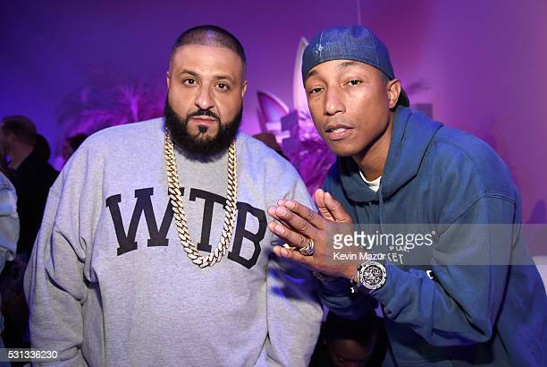 Khaled and singersongwriter Pharrell Williams attend adidas Originals Pink Beach Pharrell Williams party on May 13 2016 in West Hollywood California