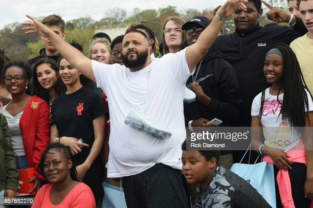 Khaled and young adults attend Champs Sports x DJ Khaled Game On Air Event In Atlanta at Maynard H Jackson High School on March 25 2017 in Atlanta...