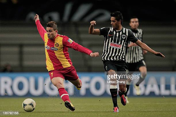 Khaled Ayari of Esperance Sportive de Tunis is challenged by Sergio Santana of Monterrey during the FIFA Club World Cup 5th Place match between Club...