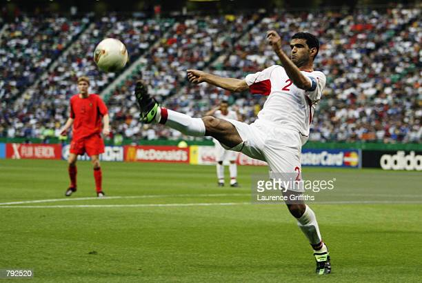 Khaled Badra of Tunisia controls the ball during the FIFA World Cup Finals 2002 Group H match between Belgium and Tunisia played at the Oita Big Eye...