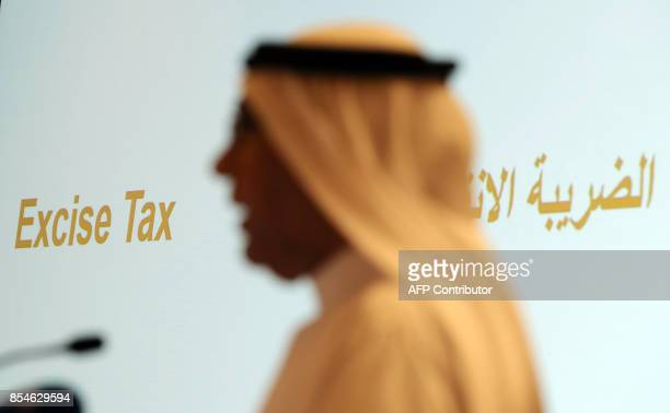 Khaled Bustani DirectorGeneral of the UAE's Federal Tax Authority speaks at a press conference in Dubai on September 27 announcing the introduction...