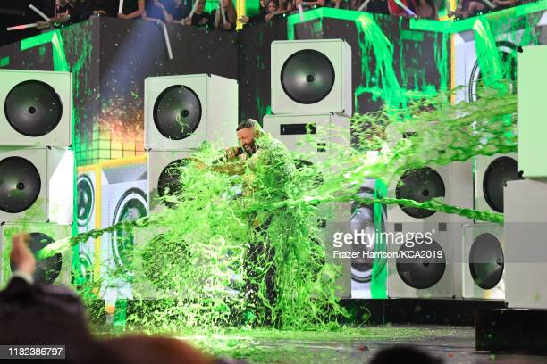 Khaled gets slimed onstage at Nickelodeon's 2019 Kids' Choice Awards at Galen Center on March 23 2019 in Los Angeles California