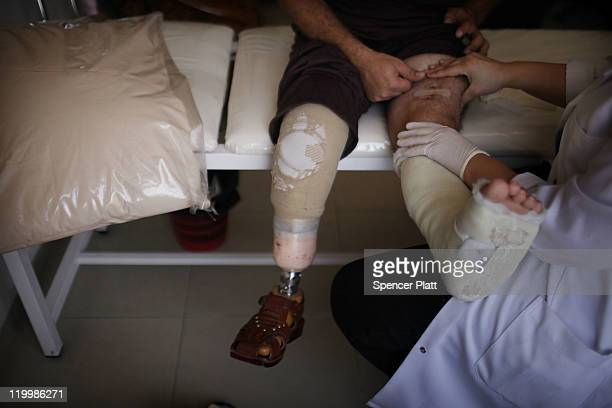 Khaled Hashem participates in physical therapy at the Red Crescent Hospital for victims of Iraq violence where Doctors Without Borders/Medecins Sans...