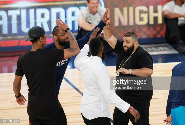 Khaled high fives Kyrie Irving of the Cleveland Cavaliers during the 2017 JBL ThreePoint Contest at Smoothie King Center on February 18 2017 in New...