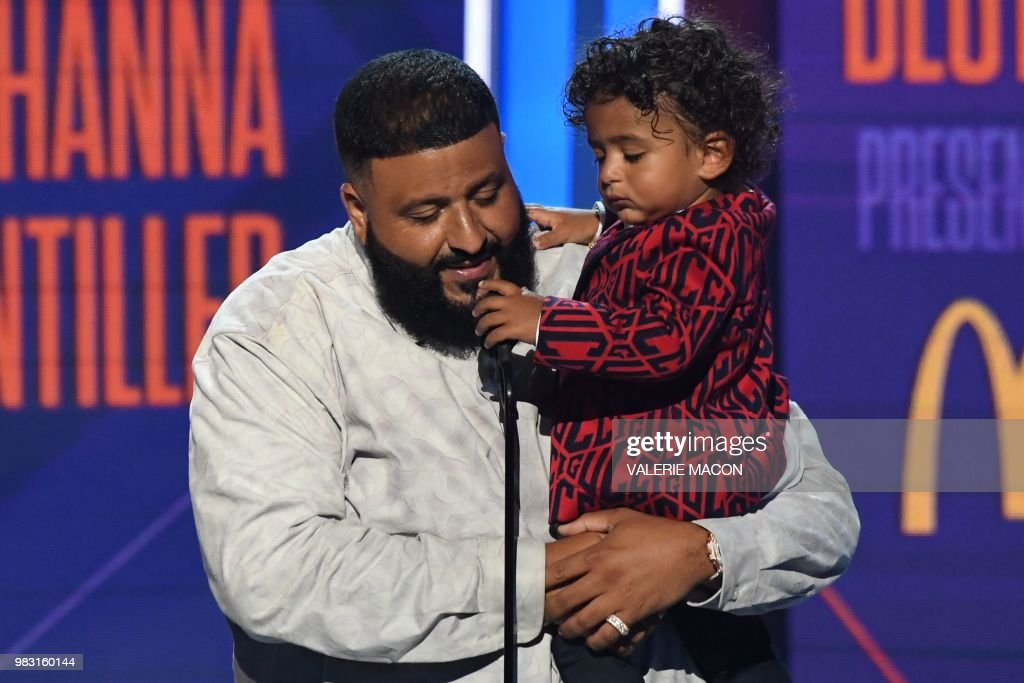 DJ Khaled holds his son Asahd Tuck Khaled as he accepts the Best Collaboration award for 'Wild Thoughts' during the BET Awards at Microsoft Theatre in Los Angeles, California, on June 24, 2018.