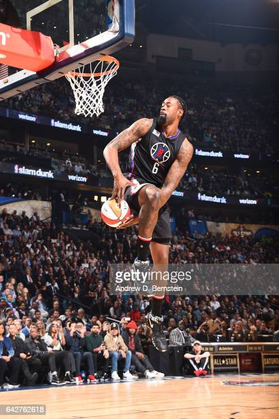 Khaled holds the ball for DeAndre Jordan of the LA Clippers during the Verizon Slam Dunk Contest during State Farm AllStar Saturday Night as part of...