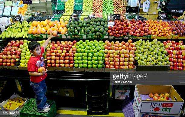 Khaled Houli aged 5 in the Camberwell Fresh Food Market THE AGE Photo by ANDREW DE LA RUE