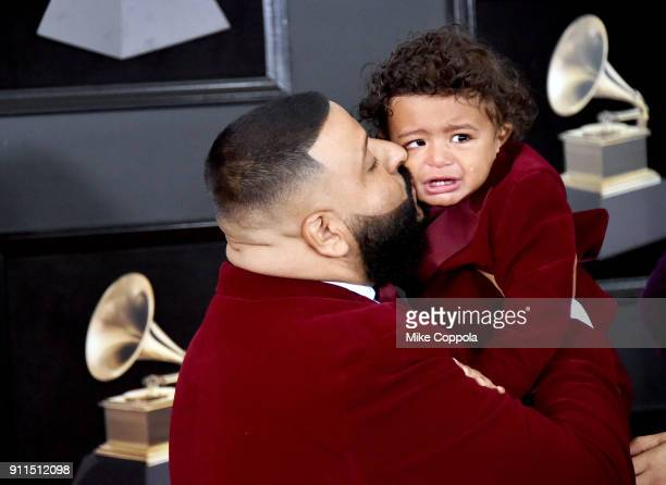 Khaled kisses his son Asahd Tuck Khaled during the 60th Annual GRAMMY Awards at Madison Square Garden on January 28 2018 in New York City
