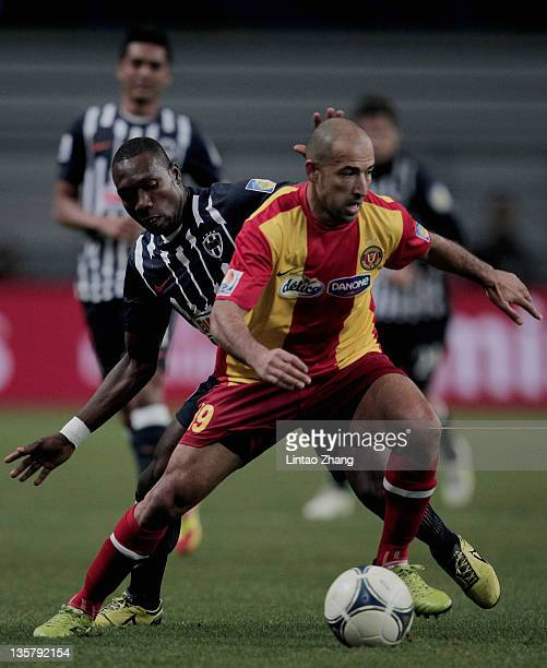 Khaled Mouelhi of Esperance Sportive de Tunis controls the ball with Walter Ayovi of Monterrey during the FIFA Club World Cup 5th Place match between...