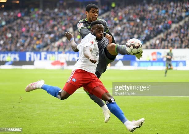 Khaled Narey of Hamburg battles for possession with Paulo Otavio Rosa Silva of FC Ingolstadt 04 during the Second Bundesliga match between Hamburger...