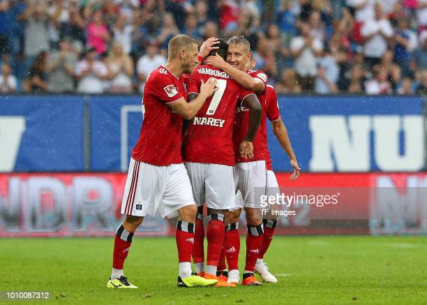 Khaled Narey of Hamburg celebrates after scoring his team`s second goal with Aaron Hunt of Hamburg Lewis Holtby of Hamburg and Jairo Samperio of...