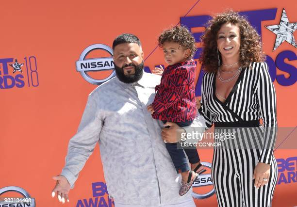DJ Khaled Nicole Tuck and Asahd Tuck Khaled pose upon arrival for the BET Awards at Microsoft Theatre in Los Angeles California on June 24 2018