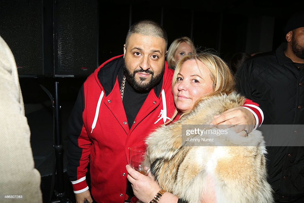 DJ Khaled (L) poses for a picture with Just Ivy's mother during the Just Ivy Private Showcase at The Glasshouses on January 31, 2014 in New York City.