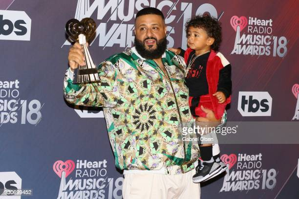 Khaled winner of HipHop Song of the Year for 'Wild Thoughts' and son Assad Khaled pose in the press room at The Forum on March 11 2018 in Inglewood...