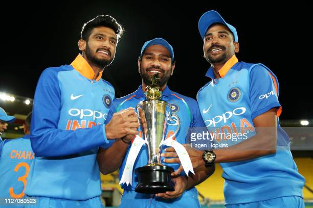 Khaleel Ahmed Rohit Sharma and Mohammed Siraj of India hold the series trophy after winning game five in the One Day International series between New...