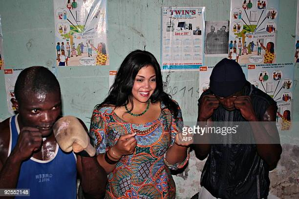 Khaliah Ali a daughter of boxing legend Muhammad Ali poses with local boxers as she tours the changing room on October 30 in the Kinshasa stadium...