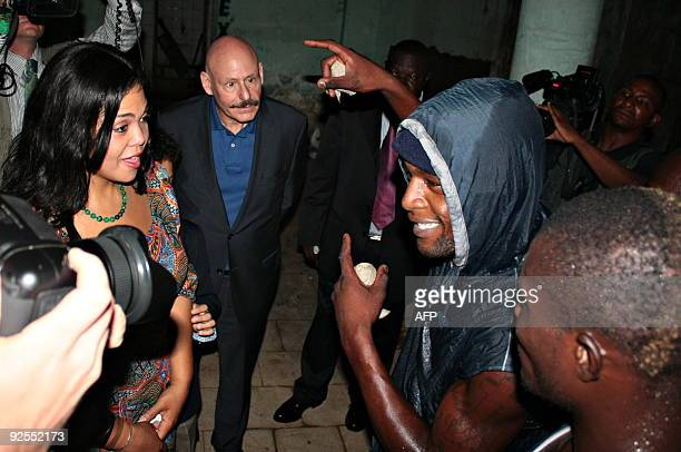 Khaliah Ali , a daughter of boxing legend Muhammad Ali speaks with local boxers as she tours the changing room, on October 30 in the Kinshasa stadium...
