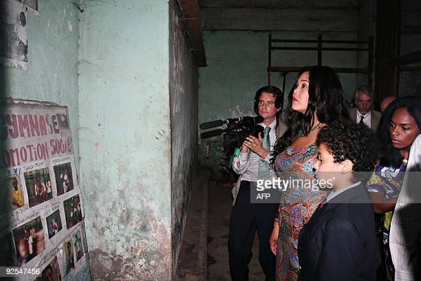 Khaliah Ali , a daughter of boxing legend Muhammad Ali stands with her unidentified son , as she tours the changing room on October 30, 2009 in the...