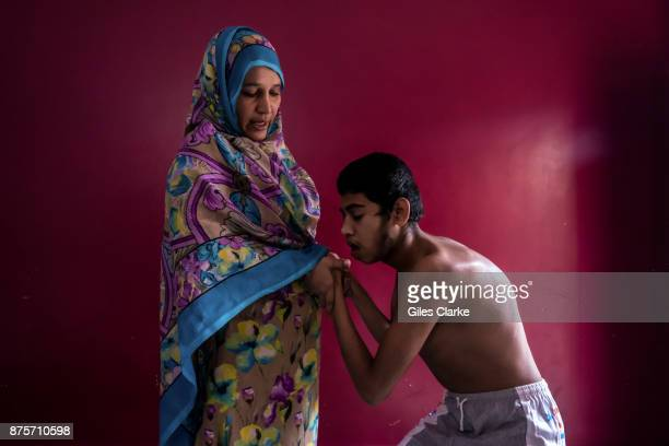 Khalid 17 years old with his mother Rajeeda Bee at home in the Indra Nagar neighborhood Khalid was born to parents contaminated by a carcinogenic and...