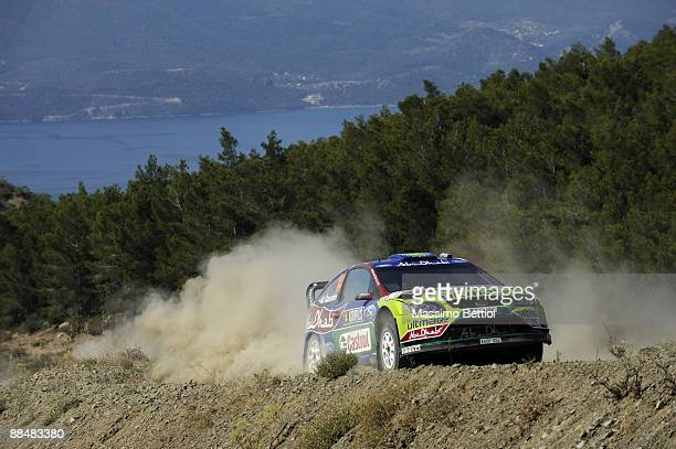 Khalid Al Qassimi of United Arab Emirates and Michael Orr of Great Britain compete in their BP Abu Dhabi Ford Focus during Leg 3 of the WRC Acropolis...