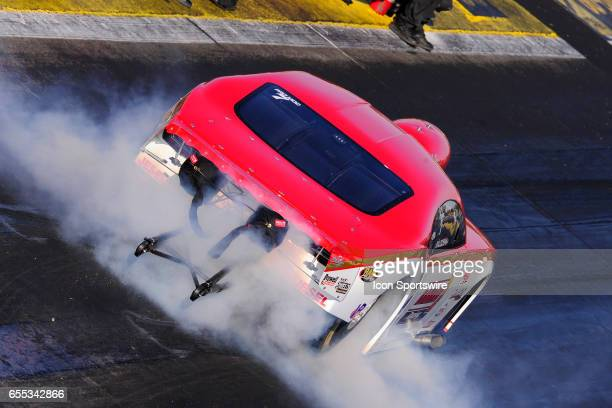 Khalid AlBalooshi 2017 Chevrolet Camaro NHRA Pro Mod does a burnout in the Amalie Motor Oil Gatornationals NHRA Mello Yello Drag Racing Series event...