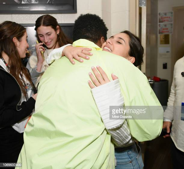 Khalid and Alessia Cara hug at Z100's Jingle Ball 2018 at Madison Square Garden on December 7 2018 in New York City