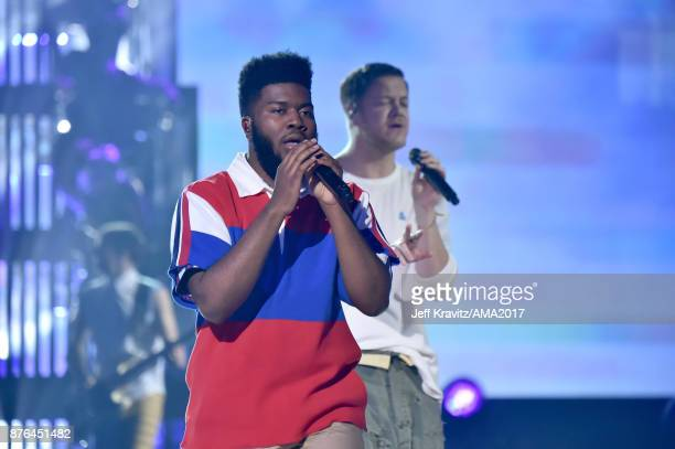 Khalid and Dan Reynolds of Imagine Dragons onstage during the 2017 American Music Awards at Microsoft Theater on November 19 2017 in Los Angeles...