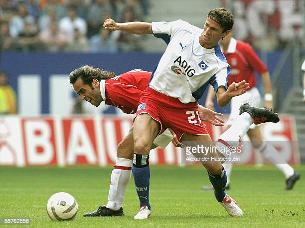 Khalid Boulahrouz of Hamburg challenges for the ball with Ali Karimi of Munich during the Bundesliga match between Hamburger SV and Bayern Munich at...
