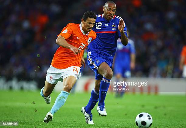 Khalid Boulahrouz of Netherlands is chased by Thierry Henry of France during the UEFA EURO 2008 Group C match between Netherlands and France at Stade...