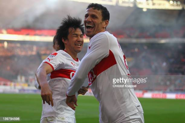 Khalid Boulahrouz of Stuttgart celebrates the third goal with Shinji Okazaki of Stuttgart during the Bundesliga match between VfB Stuttgart and SC...