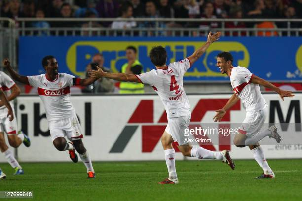 Khalid Boulahrouz of Stuttgart scores his team's second goal with team mates William Kvist and Cacau during the Bundesliga match between between 1 FC...