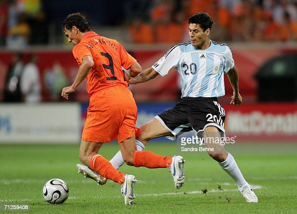 Khalid Boulahrouz of the Netherlands is brought down by Julio Cruz of Argentina during the FIFA World Cup Germany 2006 Group C match between...